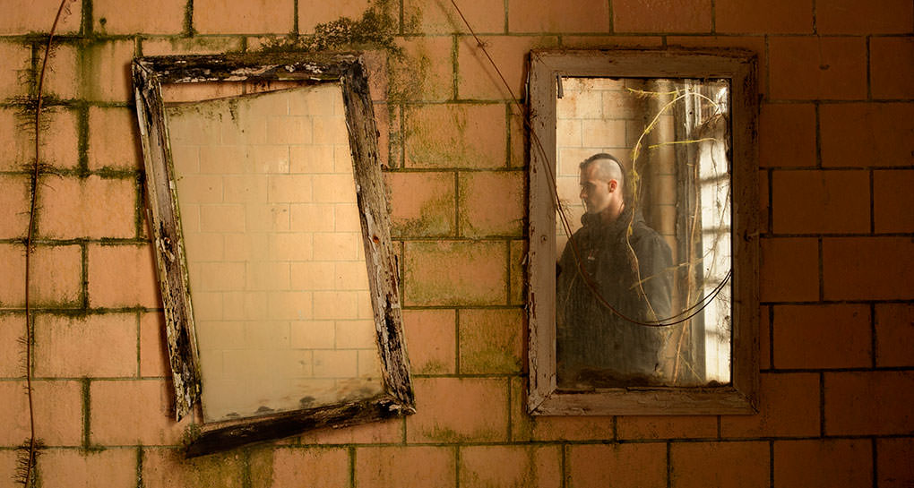 Photo of Tom Kirsch in abandoned hospital